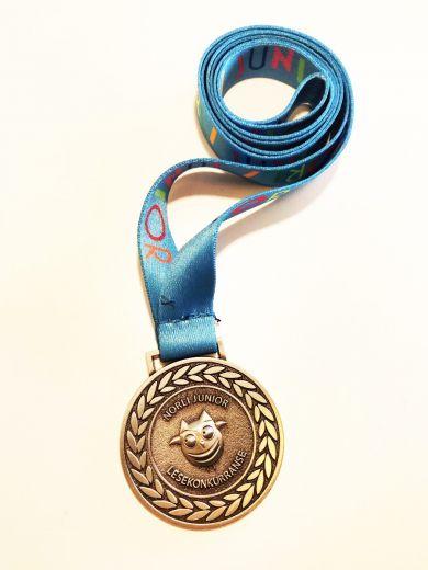 Medaljer Norli Junior Lesekonkurranse 2020: blå